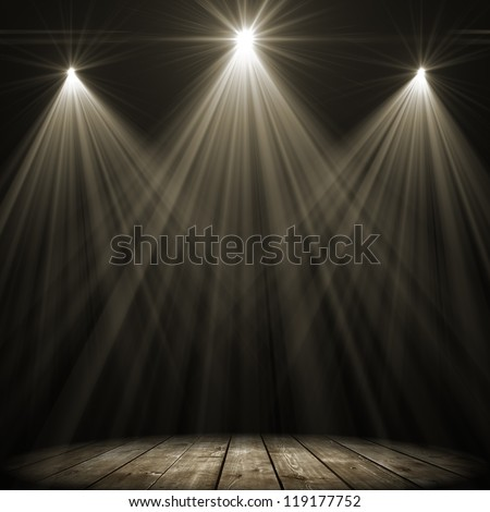 three stage spot lighting over dark background - stock photo