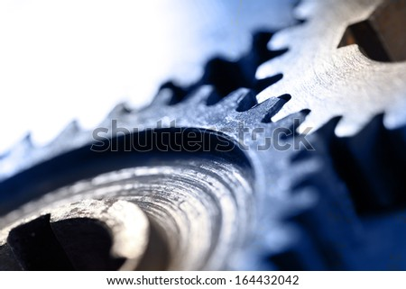 Three steel cogwheels in connection - stock photo