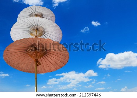 Three step of umbrella by handmade and sky. - stock photo