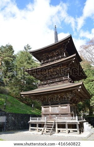 Three-story pagoda at historical temple in mountain village, Japan