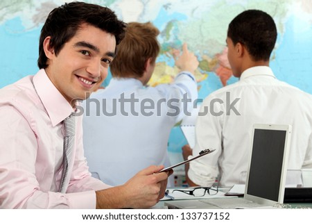 Three students in geography class - stock photo