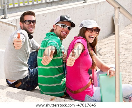 three students on the campus - stock photo