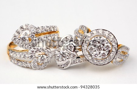 Three style of diamond rings, isolated on white. - stock photo