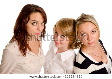 Three stylish beautiful young women posing standing close together in a row looking up at the camera isolated on white - stock photo