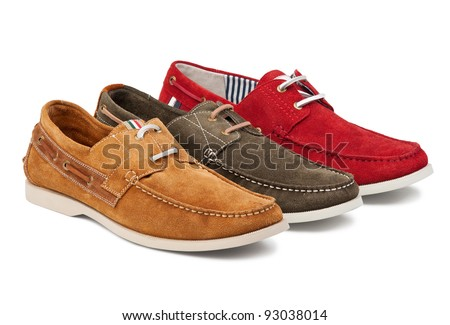 Three suede men shoes over white - stock photo