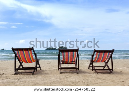 Three sun chairs on the beach of Thailand