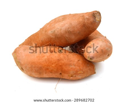 Three sweet potatoes isolated on white background