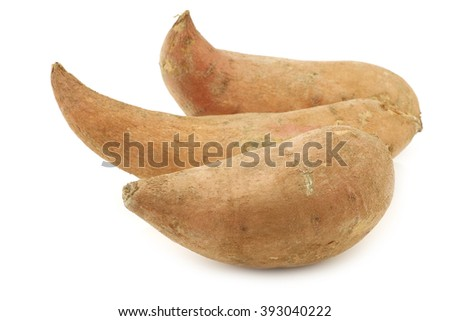 three sweet potatoes on a white background - stock photo