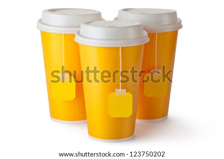 Three take-out teacups with teabags. Isolated on a white. - stock photo