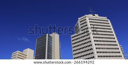 Three tall buildings against a blue sky. Israel, Tel Aviv. - stock photo
