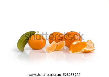 Three tangerines with leaf, peel and slices isolated on white background. Still-life picture taken in studio with soft-box.