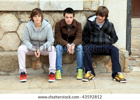 Three teenager looking at camera