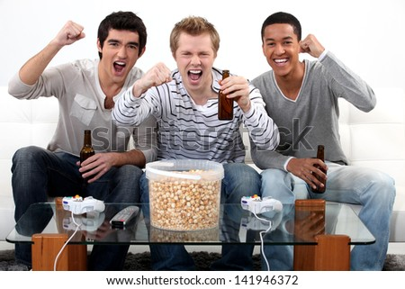 three teenagers having a party at home - stock photo