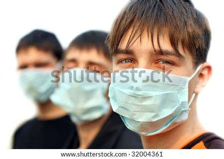 three teenagers in the flu mask