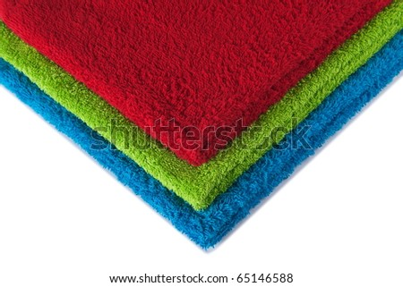 Three terry towels forming RGB colors isolated on white