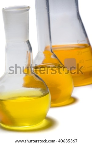 Three test tubes filled with new organic bio-fuel isolated on white. - stock photo