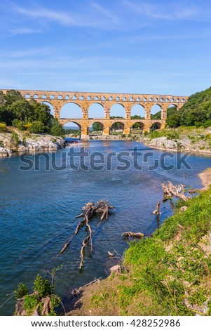 Three-tiered aqueduct Pont du Gard - the highest in Europe.  Provence, spring sunny day. The bridge was built in Roman times on the river Gardon - stock photo