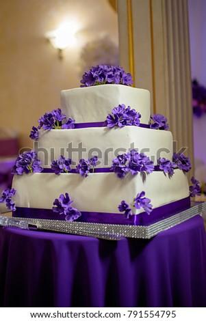 Threetiered white cake purple flowers stock photo 791554795 three tiered white cake with purple flowers mightylinksfo