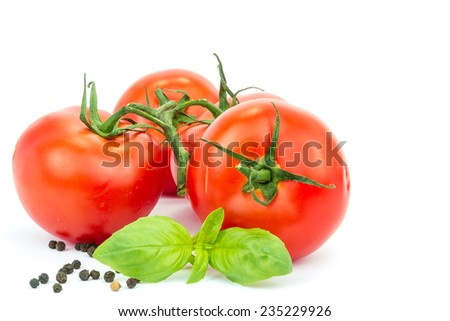 three tomato with basil leaf