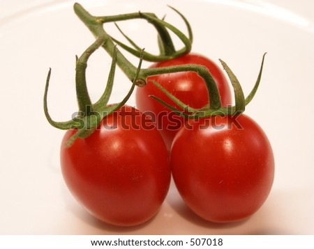 Three tomatoes - stock photo