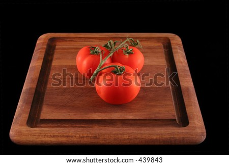 Three Tomatoes on the vine - stock photo