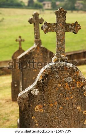 Three tombstones with crosses - stock photo