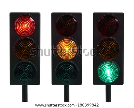Three traffic lights with red, yellow and green lights, cut out on white background - stock photo