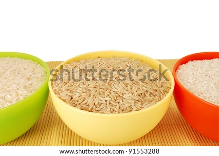 three types of rice on a white background - stock photo