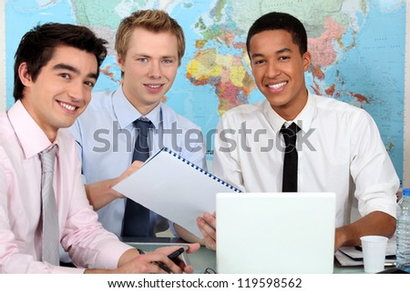 Three university geography students - stock photo