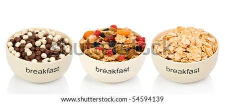 Three various types of flakes for a breakfast in plates isolated on a white background