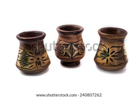 Three vase make from clay with beautiful sculpture and color put side by side forming a curve isolated on white background   - stock photo