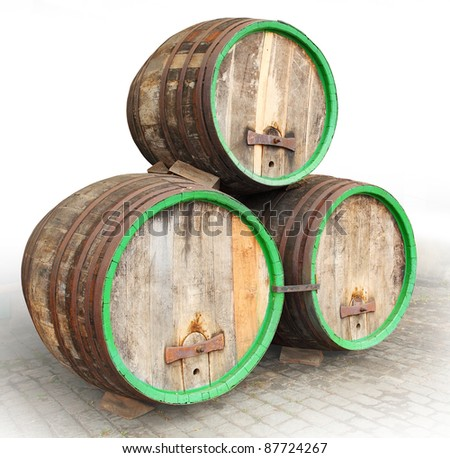 Three vintage beer barrels. - stock photo