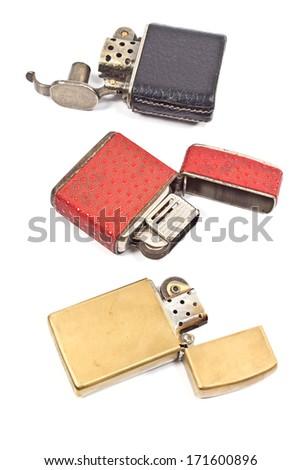 Three vintage lighter isolated on white - stock photo