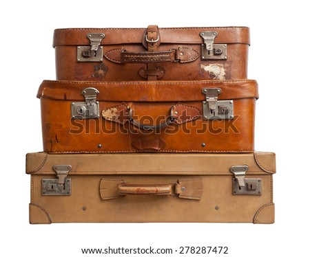 Three vintage suitcases on white background, clipping path.