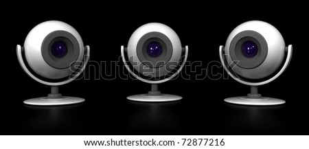 Three Web Cameras Isolated on Black Background - stock photo