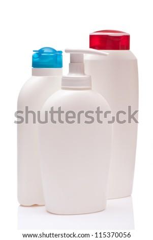 three white blank bottle, isolated on white background - stock photo