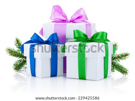 Three White boxs tied with colored satin ribbons bow and pine tree branch Isolated on white background