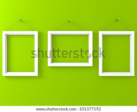 three white frame on the green wall - stock photo