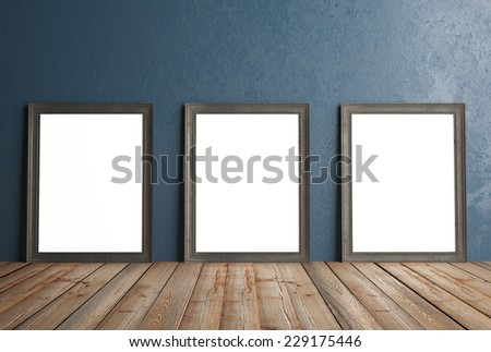 three white frames hanging on a blue wall, 3d render - stock photo