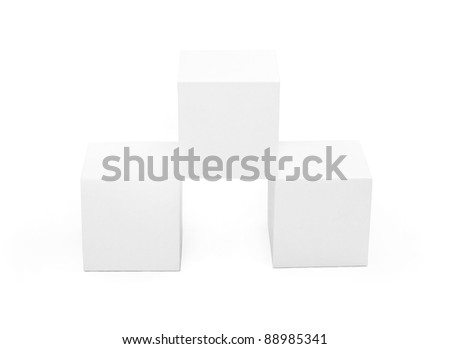 three white paper cubes on a white background - stock photo