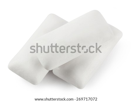 Three white paw chewing gum isolated on white background - stock photo