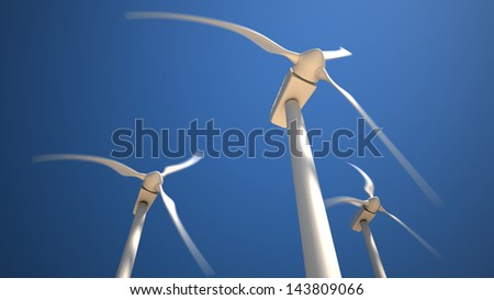 Three white wind turbines with rotating blades on the blue sky background - stock photo