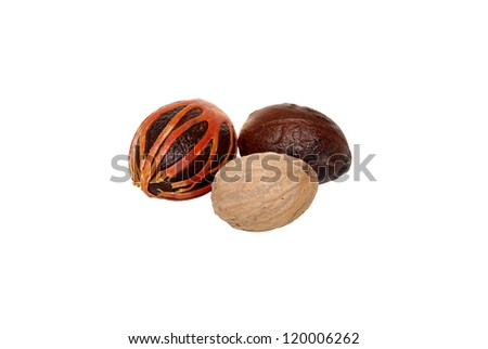 Three whole nutmegs - covered in mace, in case and seed, isolated on a white background