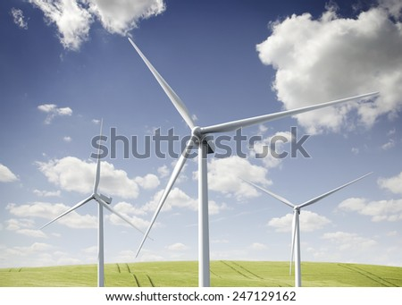 Three wind turbines on a summer day. - stock photo