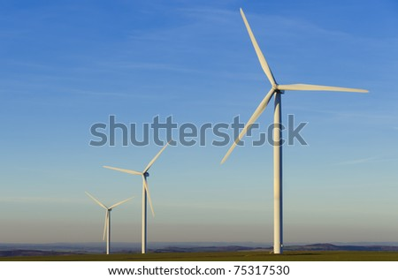 three windmills in the countryside