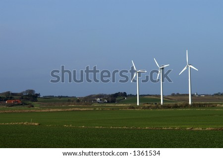 Three windmills in the danish farmland