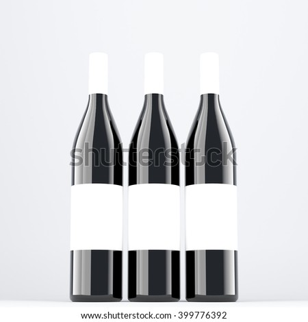 Three wine bottles aranged in line, blank labels on them. Dark glass. Concept of bottling wine. Mock up. 3D rendering. - stock photo