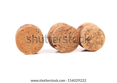 Three wine corks. Isolated on a white background. - stock photo