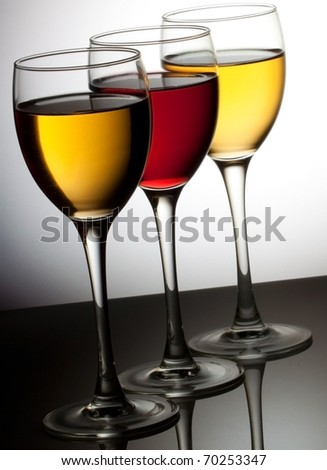 Three wine glass with red and white wine