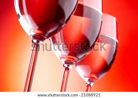 Three wine glasses on red background - stock photo